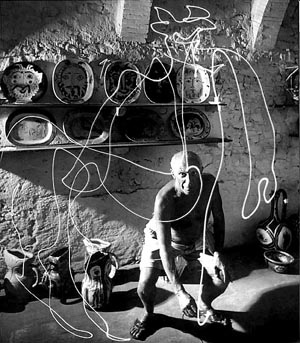 Pablo Picasso painting with light photo by Gjon Mili