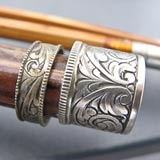 Metal hand engraving on a bamboo rod